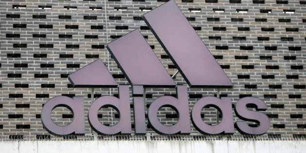 The logo of Adidas is seen on an outlet store in Metzingen, Germany, June 16, 2017. REUTERS/Michaela