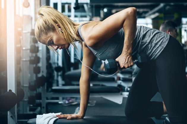Shot of a sporty woman working out on her own in the gym