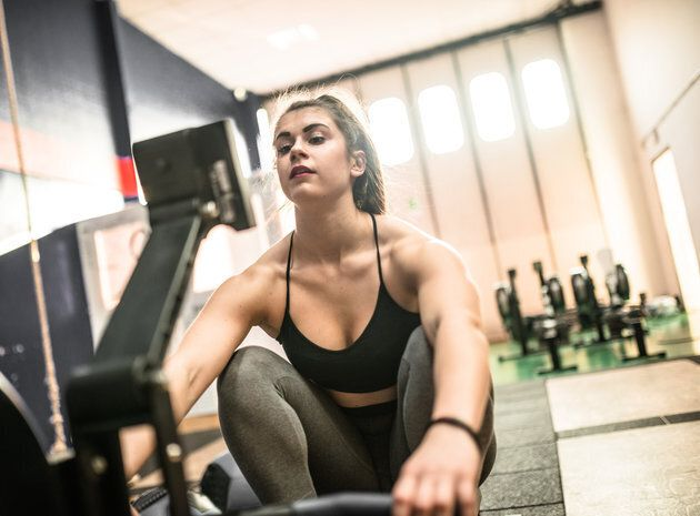 Woman pulling at the rowing machine