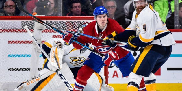 MONTREAL, QC - MARCH 02: Brendan Gallagher #11 of the Montreal Canadiens and Ryan Ellis #4 of the Nashville Predators battle for position near goaltender Pekka Rinne #35 during the NHL game at the Bell Centre on March 2, 2017 in Montreal, Quebec, Canada. (Photo by Minas Panagiotakis/Getty Images)