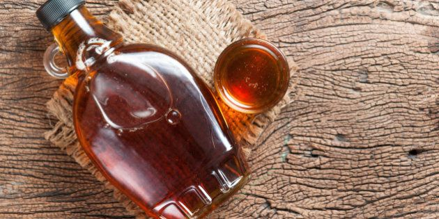 maple syrup in glass bottle on wooden