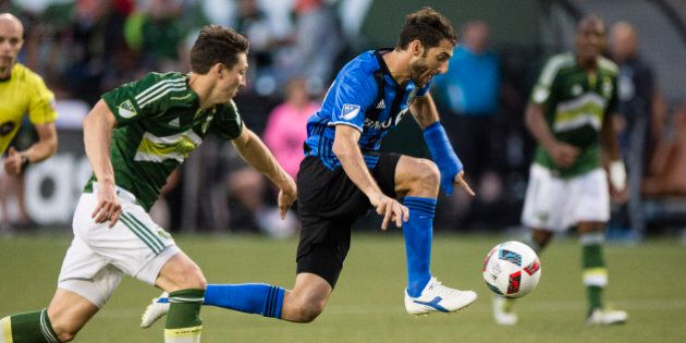 Jul 13, 2016; Portland, OR, USA; Montreal Impact midfielder Ignacio Piatti (10) takes a pass up the field...