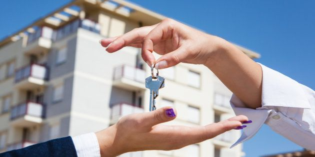 Realtor is giving the keys to an apartment to some clients aa focus on the