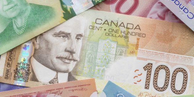 Close-up of Canadian dollar bills spread