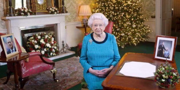 LONDON, ENGLAND - DECEMBER 24: Queen Elizabeth II sits at a desk in the Regency Room after recording...