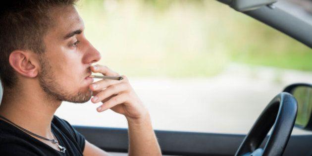 Man driving and smoking