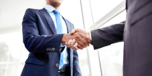 Handshake of two business people in the