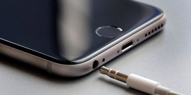 This Sept. 2, 2016, photo shows the earphone jack and charging port on an Apple iPhone 6, in New York....