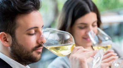 56695248 - close up portrait of young couple tasting white wine tasting.