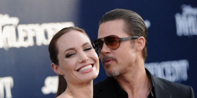 HOLLYWOOD, CA - MAY 28: Actors Angelina Jolie and Brad Pitt arrive at the World Premiere of Disney's...