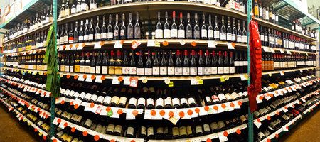73738251 - red wine aisle in a bottle king store. bottle king is the largest new jersey retailer of wine, beer and spirits.