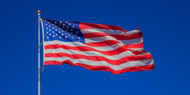 United States flag waving in clear sky