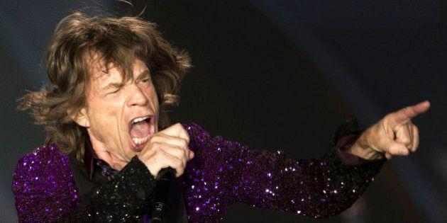 Rolling Stones singer Mick Jagger performs during a concert in Hayrkon Park in Tel Aviv, Israel, Wednesday,...