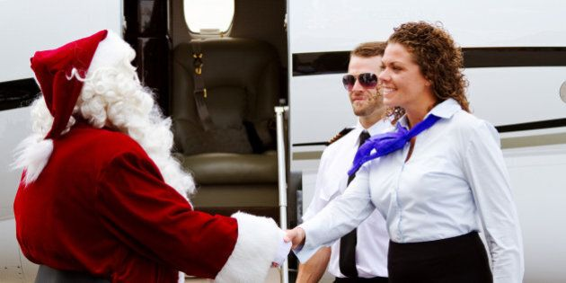 Santa Claus being greeted as he enters