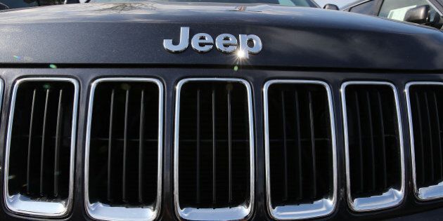 MIAMI, FL - APRIL 22: A 2015 Jeep Grand Cherokee vehicle is seen on a sales lot as Fiat Chrysler Automobiles announced that it is recalling more than 1.1 million cars and SUVs worldwide because the vehicles may roll away after drivers exit the vehicles on April 22, 2016 in Miami, Florida. The recall covers the 2012-2014 Dodge Charger and Chrysler 300 sedans and 2014-2015 Jeep Grand Cherokee sport utility vehicles. (Photo by Joe Raedle/Getty Images)