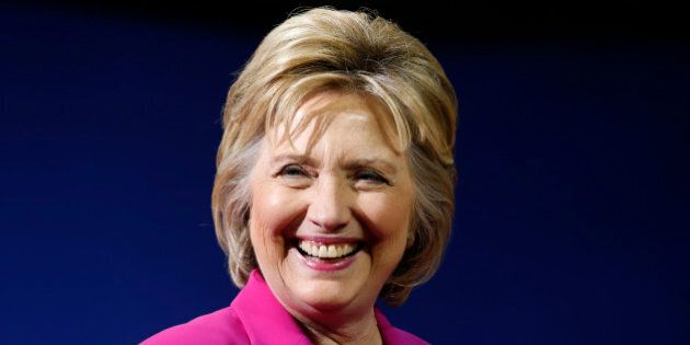 Democratic U.S. presidential candidate Hillary Clinton smiles during a campaign rally, where she received...