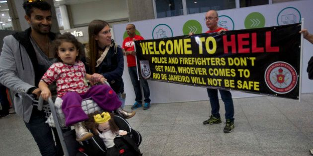 A family arrive to Brazil, while they walk past a banner that