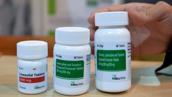 Antiretroviral (ARV) medicines for HIV are displayed at a stand on December 8, 2017 in Abidjan, as part of the 19th ICASA conference (International Conference on AIDS and STIs in Africa). / AFP PHOTO / SIA KAMBOU        (Photo credit should read SIA KAMBOU/AFP/Getty Images)
