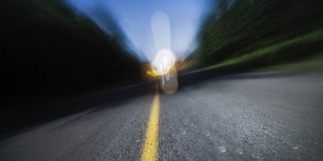 Drunk Driving, Speeding, Being too Tired to Drive are Potential Concepts for This Image of Blurry Road...