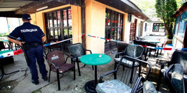 A police officer stands in a cafe after a shooting during a local festival in the village of Zitiste,...