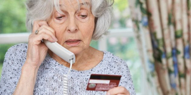 Senior Woman Giving Credit Card Details On The