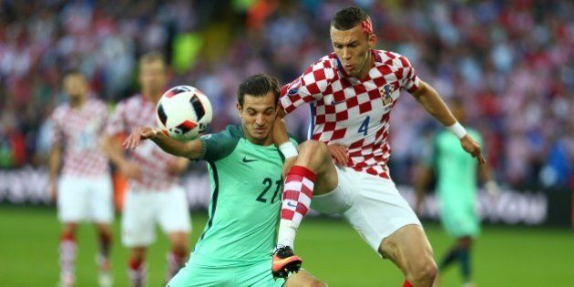 LENS, FRANCE - JUNE 25: Ivan Perisic (R) of Croatia in action against Cedric (L) of Portugal during the...