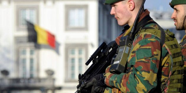 Belgian soldiers guard outside the U.S. Embassy in Brussels, near the Belgian Parliament January 17,...