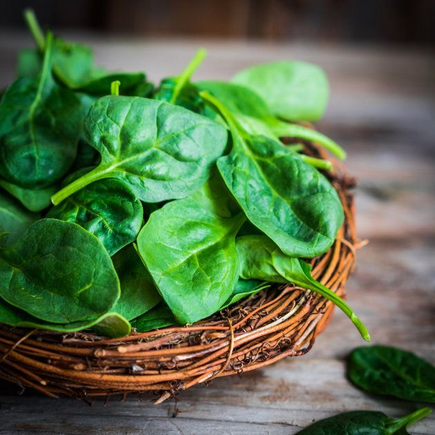 Fresh spinach on rustic wooden backgroundFresh spinach on rustic wooden