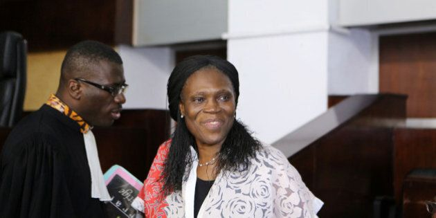 Ivory Coast's former first lady Simone Gbagbo (R), who is accused of crimes against humanity and war...