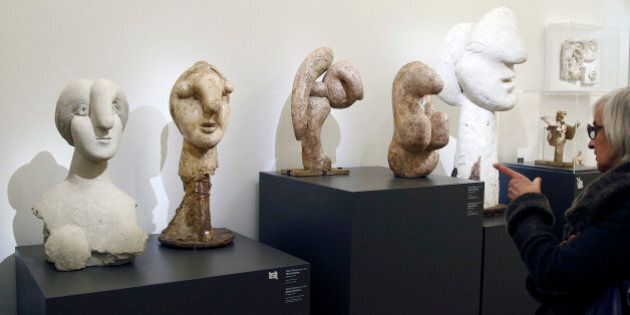 PARIS, FRANCE - MARCH 16: Visitors looks at sculptures 'Head of a woman' and 'Bust of a woman' by Pablo...