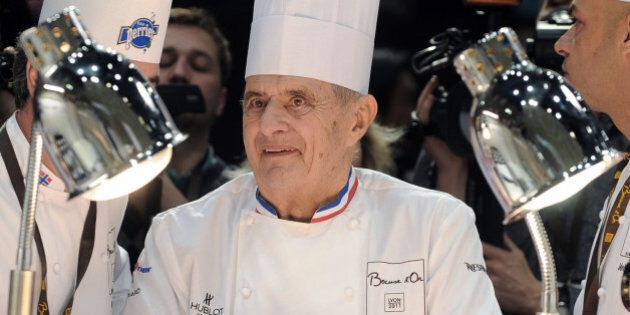 French Chef Paul Bocuse (C) and his son Jérôme (R) attend the 13th edition of the world final of the international culinary competition of the Bocuse d'Or (Golden Bocuse), on January 25, 2011 in Lyon, central eastern France.   AFP PHOTO / PHILIPPE MERLE (Photo credit should read PHILIPPE MERLE/AFP/Getty Images)