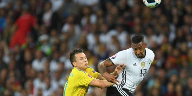 Germany's defender Jerome Boateng (R) vies with Ukraine's midfielder Yevhen Konoplyanka during the Euro...