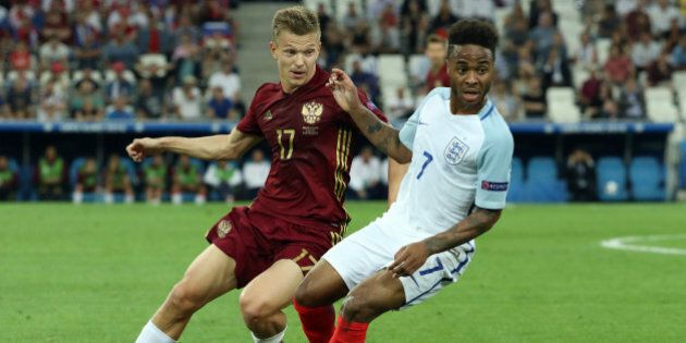 MARSEILLE, FRANCE - JUNE 11: Raheem Sterling of England holds off Oleg Shatov of Russia during the UEFA...
