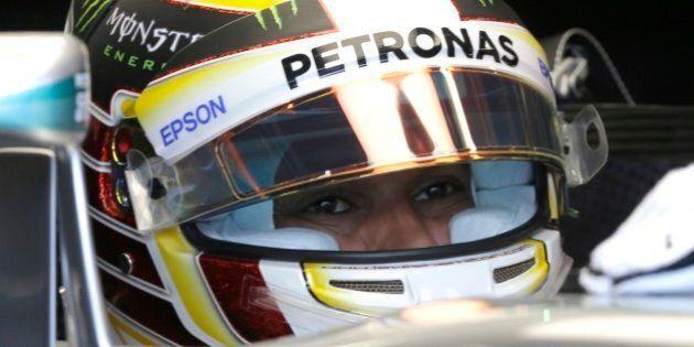 Mercedes driver Lewis Hamilton of Britain in his car during the third free practice at the Monaco racetrack,...