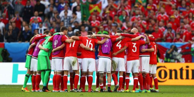 BORDEAUX, FRANCE - JUNE 11: Wales players huddle to celebrate their team's 2-1 win in the UEFA EURO 2016...