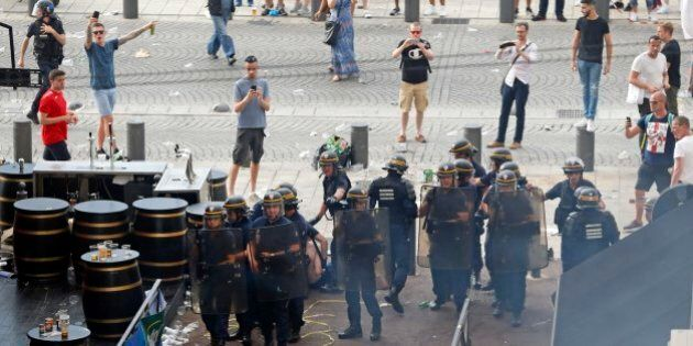 French police officers form a line in downtown Marseille, France, Friday, June 10, 2016. Some minor scuffles...