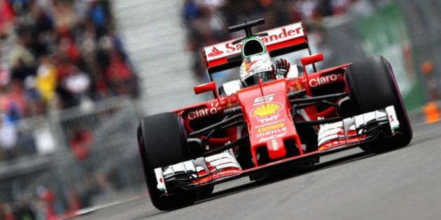 MONTREAL, QC - JUNE 11: Sebastian Vettel of Germany driving the (5) Scuderia Ferrari SF16-H Ferrari 059/5...