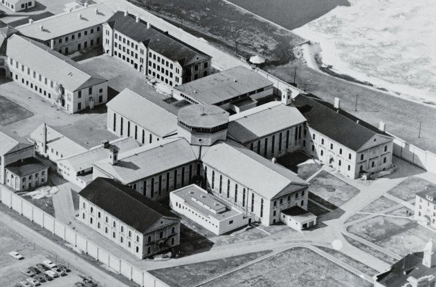 (Original Caption) Kingston, Ontario, Canada: Aerial view shows the area that is under siege by some 400 inmates at the Kingston Penitentiary. The four-way cell block in the middle is the area where prisoners are holding six guards hostage till the prison meets their demands. UPI Telephoto.