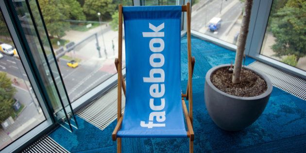 A picture shows the Facebook logo on a beach chair at the Facebook office in Berlin, Germany, August...