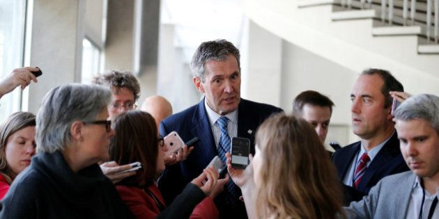 Manitoba Premier Brian Pallister speaks to journalists at the First Ministers' meeting in Ottawa, Ontario,...