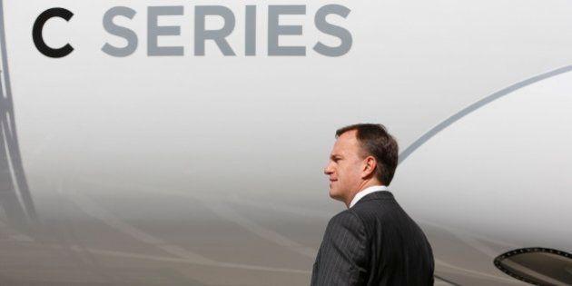 TORONTO, ON - SEPTEMBER 10: President of Bombardier Fred Cromer tours the new CS100 jet in Toronto, Ontario....