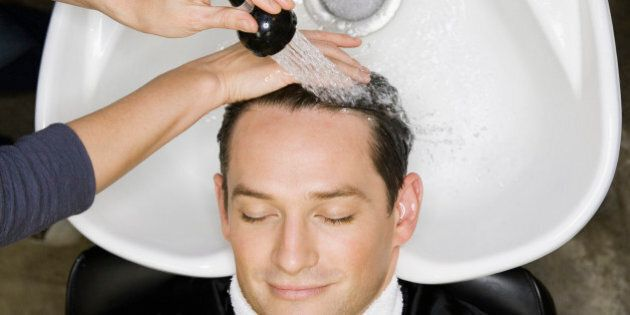 Man having hair washed at