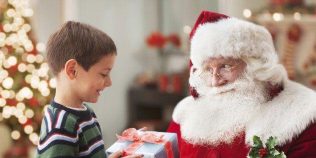 Santa giving Caucasian boy Christmas