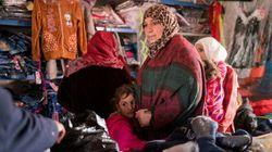 Une famille syrienne se prépare pour l'hiver en