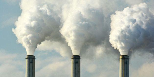 Multiple Coal Fossil Fuel Power Plant Smokestacks Emit Carbon Dioxide