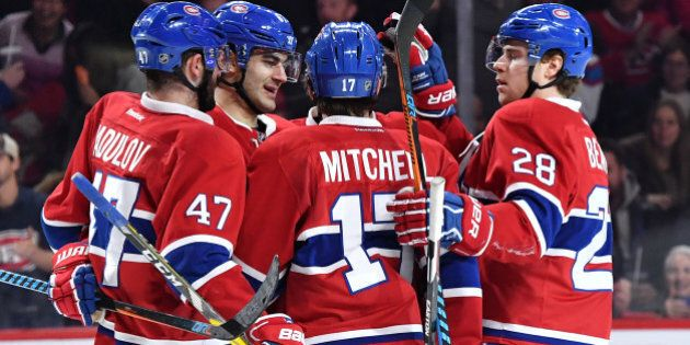 MONTREAL, QC - DECEMBER 10: Max Pacioretty #67 of the Montreal Canadiens celebrate after scoring a goal...
