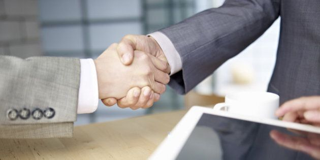 business people shaking hands in