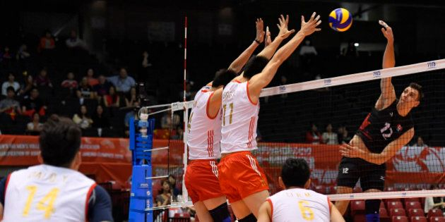 TOKYO, JAPAN - JUNE 05:Graham Vigrass #1 of Canada spieks the ball during the Men's World Olympic Qualification...