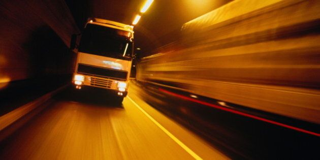 Lorry travelling through tunnel (blurred motion)