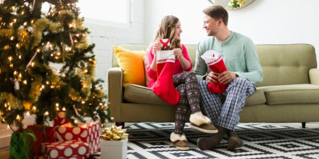 Young couple with Christmas stockings on